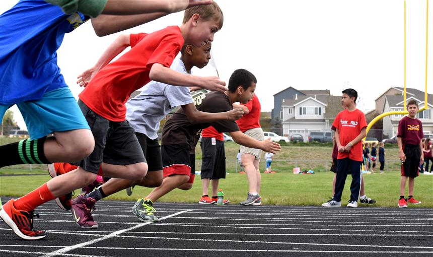 Boys take off during a sprint at the District 49 field day.