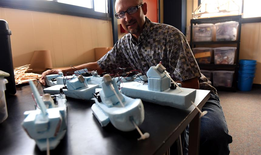 Paul Austin with student design drag racing boats.