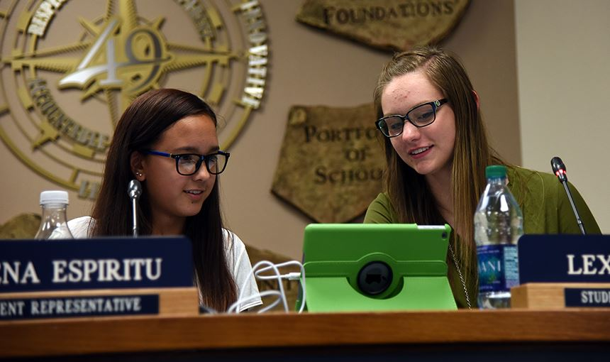 Athena Espiritu, 14, a PPEC student and Lexi Boone, 16, a FHS student sit down Sept. 14.