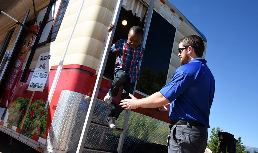 Jordan Traylor, 6, a first-grader at RES, climbs out of a bedroom window Sept. 15.