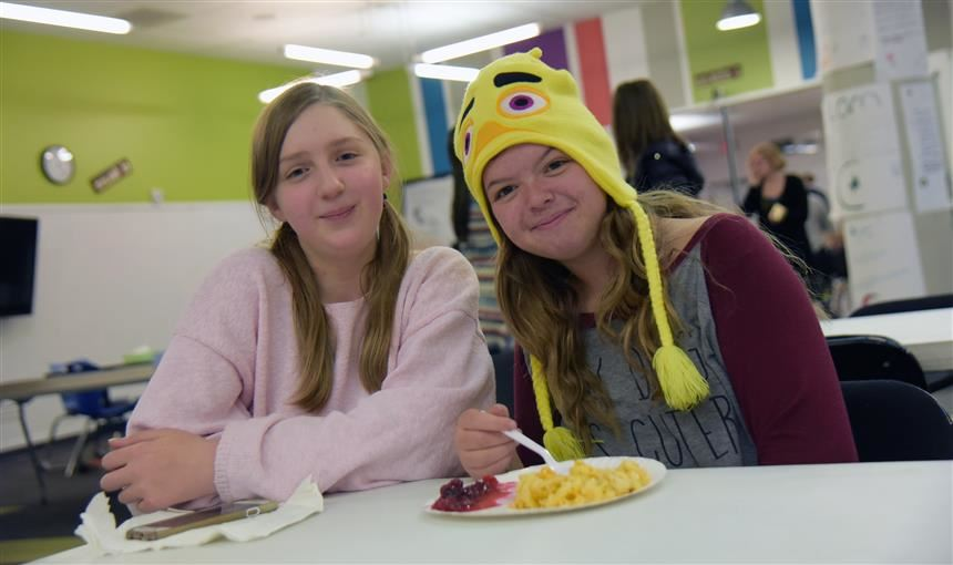 Students at SSAE enjoy a meal together at the school's Harvestmania event Nov. 9.