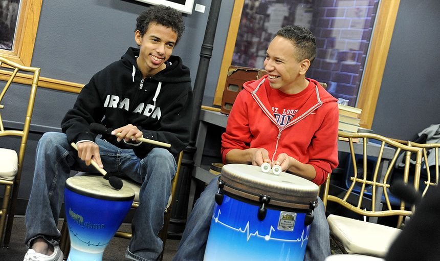 Sand Creek High School tenth-graders Dayshawn Powell, 15, and Carlos Atencio, 18, play drums .