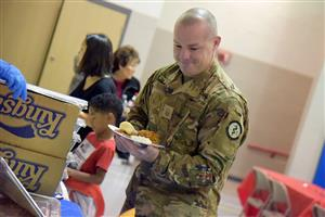 Military guests enjoy a special meal at the appreciation luncheon at RES Nov. 13.
