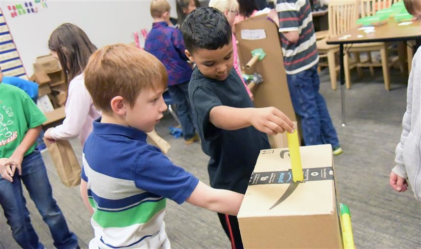 Students try out games at the WHES cardboard arcade Nov. 28.