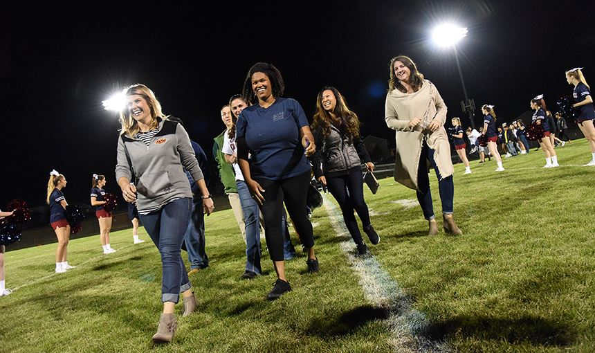 Sand Creek High School alumni are recognized during halftime of the homecoming game Sept. 22.