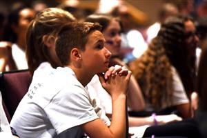 Robby Warkentine, an eighth-grader at Falcon Middle School listens to District 49 CEO Peter Hilts at the MSLC at SCHS 4/15.