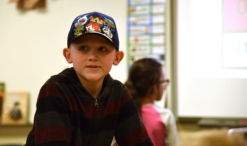 Caleb Wimer wears a hat in class Sept. 26 after paying one dollar to help hurricane victims in Tx.