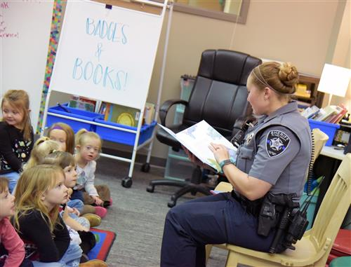 "Police deputy shares a book called, ""The Rainbow Fish,"" with kindergartners at Woodmen Hills Elementary School Jan. 11"