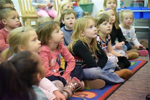 Young learners listen attentively at the Badges and Books event at Woodmen Hills Elementary School Jan. 11.