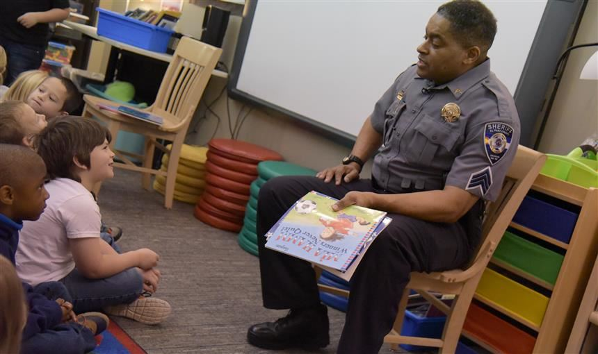 Police sergeant shares a story with young scholars at Woodmen Hills Elementary School Jan. 11.