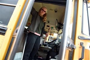 Leatha Hansz closes the door to her bus after performing a pre-trip inspection May 11.