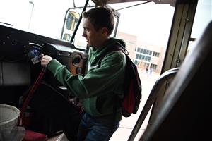 A Falcon High School student gets on the purple 7 bus driven by Leatha Hansz.