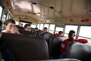 Falcon High School students ride the purple 7 bus on May 11.