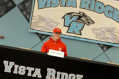 Twelfth-grader Justin Risdall, 17, celebrates after signing a letter of intent