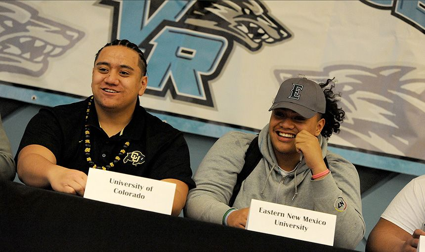 Twelfth-graders Jalen Sami, 17, and Philip Tuiava, 17, prepare to sign letters of intent.