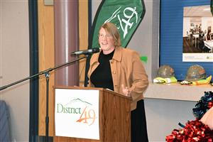 Marie LaVere-Wright, President of the District 49 Board of Education, addresses attendees at a wall-breaking ceremony June 6.