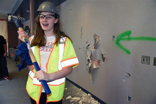 Madelyn Wells, 14, tenth-grader at SCHS smiles after smashing a wall June 6.