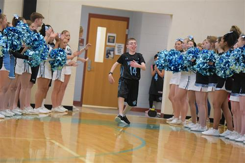 Team member heads onto the court for the Unified basketball game April 24 at VRHS.