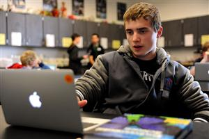 Jay Barnish, a senior at Falcon Virtual Academy, works on an Environmental Science project April 21.