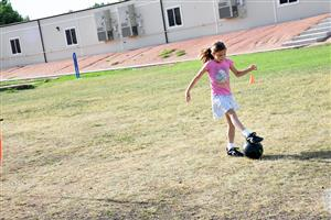 "Rebekah Doebler, 7, third grader at RES, works on ball control skills at ""kick around."""