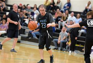 Player heads down court during the Unified basketball game April 24 at VRHS.