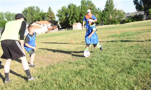"Kids work to make a play at ""kick around"" event at EIES June 19."