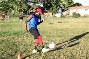 "Joel Walker, 18, recent VRHS graduate, dribbles the ball during ""kick around"" event."