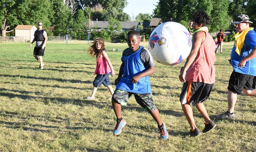 "Karim Fudge, 10, sixth grader at BLRA, launches the ball into the air during ""kick around."""
