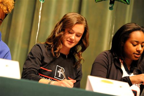 Twelfth-grader Kaitlin Malone, 17, signs a letter of intent April 12 at Falcon High School.