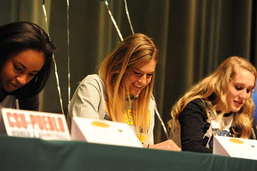 Twelfth-grader Hanna Diaz, 17, signs a letter of intent April 12 at Falcon High School.
