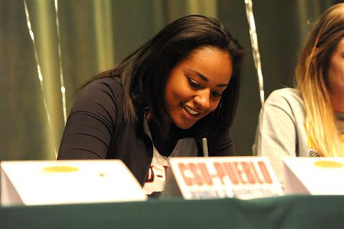 Twelfth-grader Jade Adams, 17, signs a letter of intent April 12 at Falcon High School.