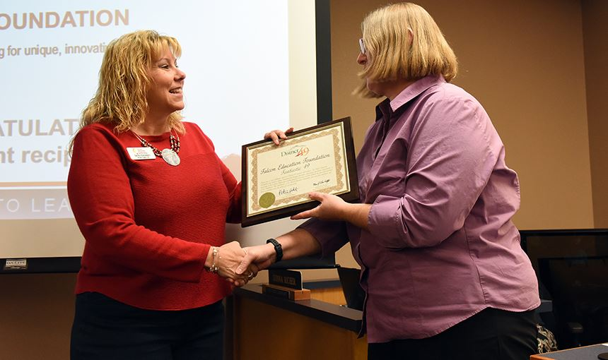 Sandi Esparsen receives a plaque of appreciation from Marie LaVere-Wright Nov. 9.
