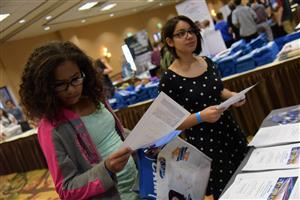 Eighth grade girls check out job opportunities at College and Career Fair Sept. 15.
