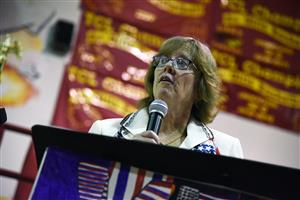 Karen Hobson, FMS administrative assistant and veteran, addresses the crowd Nov. 10.