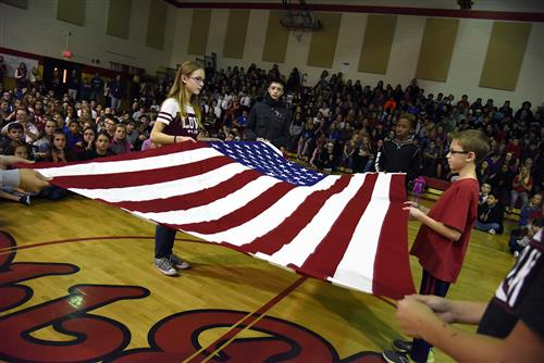 FMS students perform a flag folding ceremony Nov. 10.