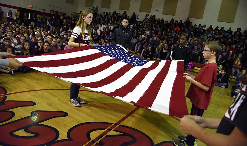Falcon Middle School students perform a traditional flag folding ceremony Nov. 10.