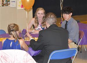 FHS seniors Bailey Shaw (left) and Kegan Hoang (right) chat with an eS2S family from Rocky Mountain Classical Academy Jan. 26