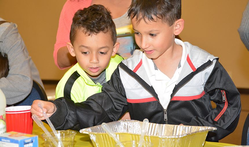 Royce Sanyo, 4, preschool  student at OES, and his brother Rand Kai, 8, conduct an experiment 4/18.