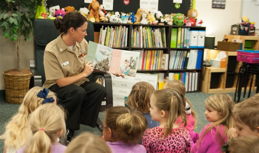Jessica Demarco reading to first grade class during veterans day