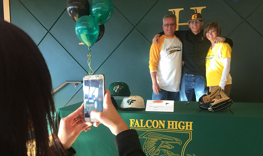 Darrian Escobar-Winter gets a photo taken after signing NLI on Nov. 8,