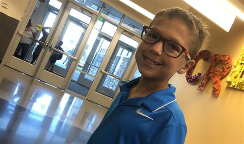 Callan Willis, third-grader, first student through the doors first day of school