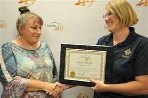 Falcon Homeschool Program paraprofessional is recognized during the Fantastic 49 celebration Sept. 12.