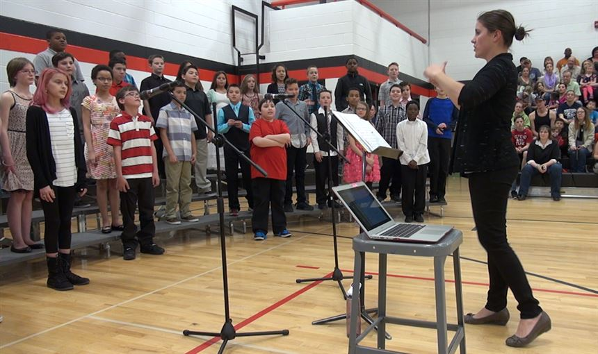 Bethany Meyer, HMS choir director, leads a student performance March 16.