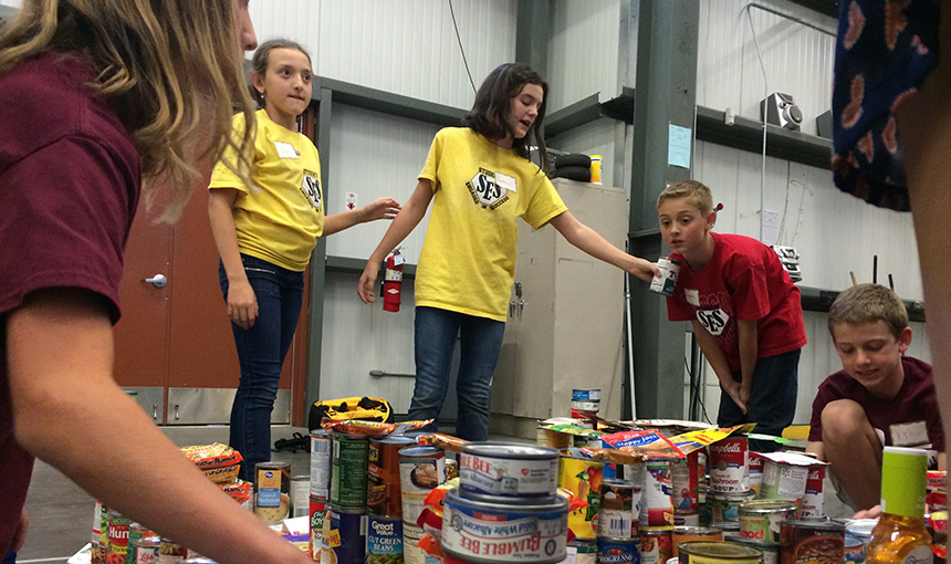 Baylea Larson and other Stetson Elementary School students work on their canstruction project.