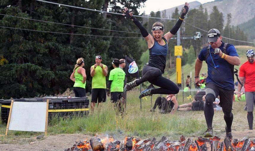 Kendra Spencer, fourth grade teacher at SES, leaps during Spartan Race Aug. 26 in Breckenridge.