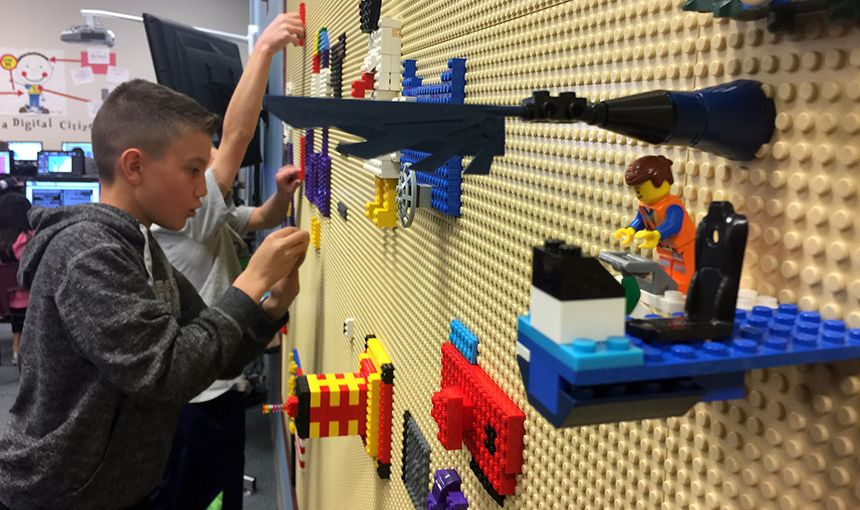"Stetson Elementary School fifth-grader David Strock, 11, builds at a new ""LEGO wall"" March 7."