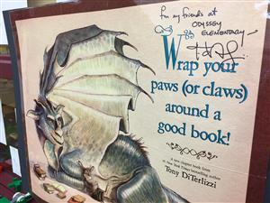 "Tony DeTerlizzi, author of ""Kenny and the Dragon,"" presented Odyssey Elementary School with a signed poster."