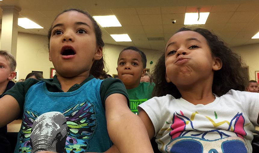 "RMCA first-graders Cameron Lewis, 6, and Jayda Joe, 7, react to a magic trick during ""The NED Show."""