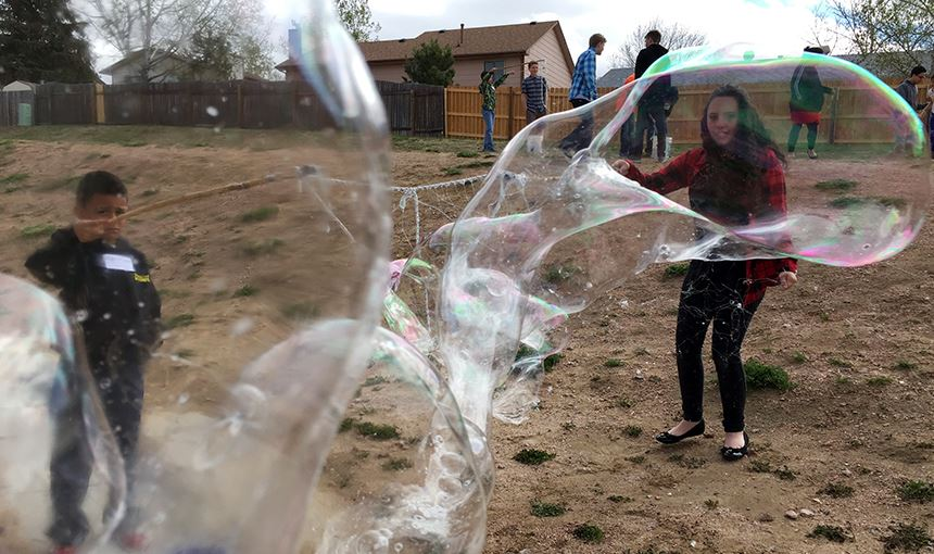 HMS students teach second-graders from RES about surface tension using giant bubbles May 3.
