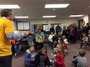 Mike Pickering, POWER Zone leader, reads to SES students and parents during literacy night May 18.